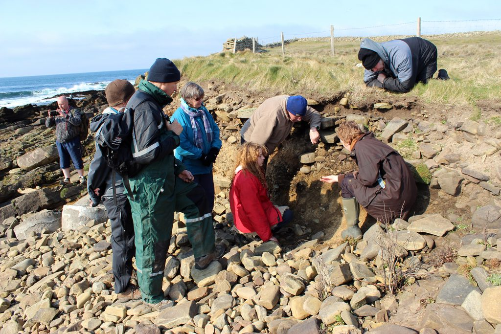 We are looking closely at possible evidence of metal working in an undated building eroding out of the coast edge at the Ebb of Seater.