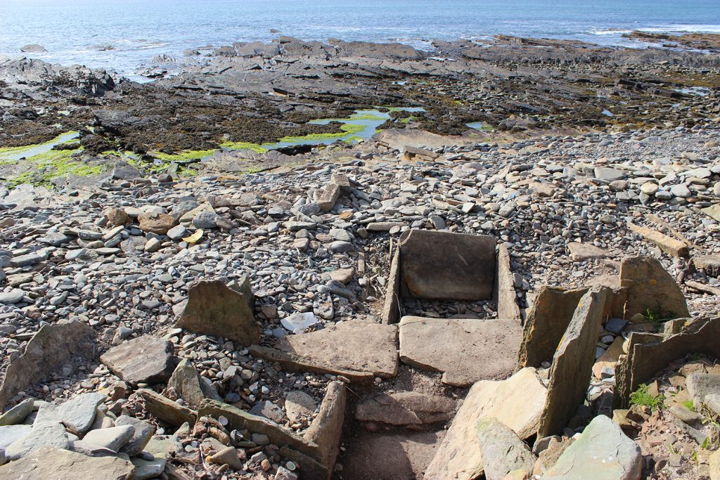 The stone tank and remains of other structures of the Meur burnt mound. You can see how close to the sea it is.