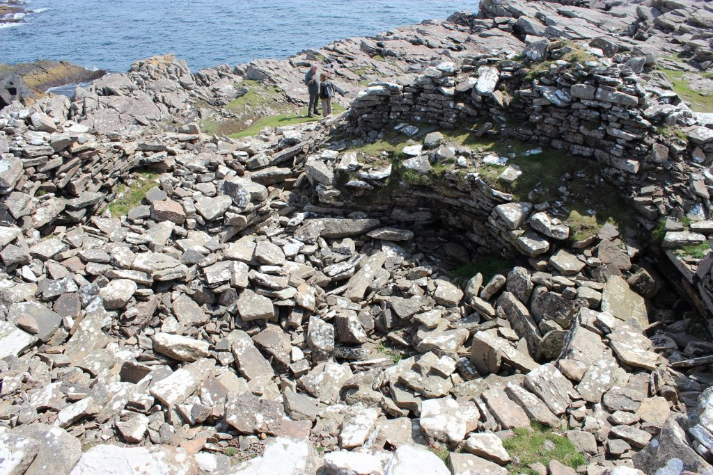 Looking into Levenwick Broch. You get a sense of scale from Jim and Ellie in the background.