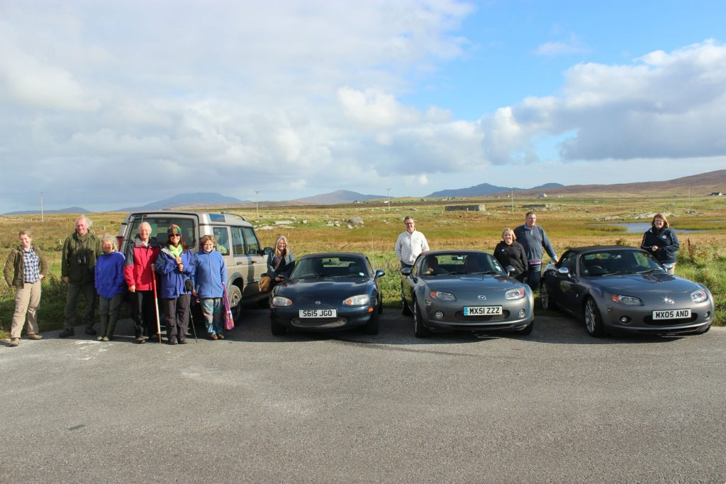 What are the chances of meeting an outing of Mazda sports cars down a farm track in South Uist? Annie's is next to the land rover.