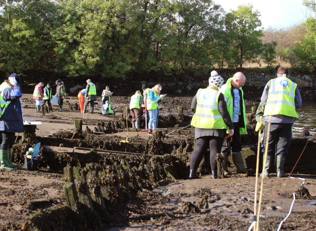 Volunteers recording mud punts at the Newshot ship graveyard