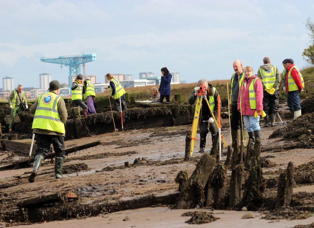 Volunteers surveying wooden wrecks on the Clyde Foreshore