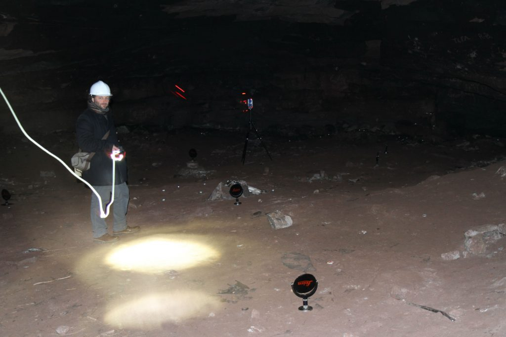 The process of laser scanning captured in this spooky image taken in the dark cave space of the Well Cave