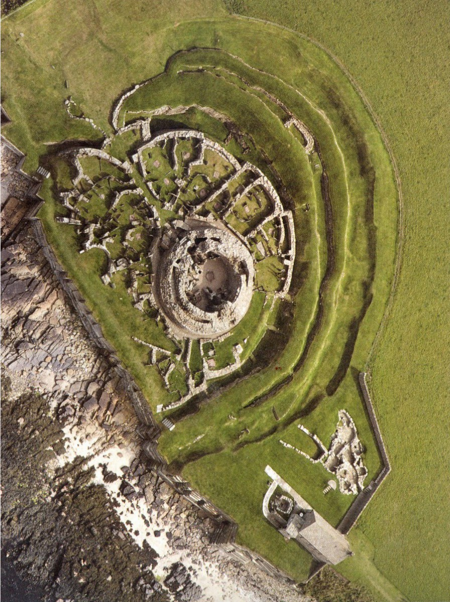 Aerial view of the Broch of Gurness, Orkney. You get some idea of what Sna Broch would have looked like. It's unlikely the banks would ever have completely encircled the living area. The sea formed part of the defences.