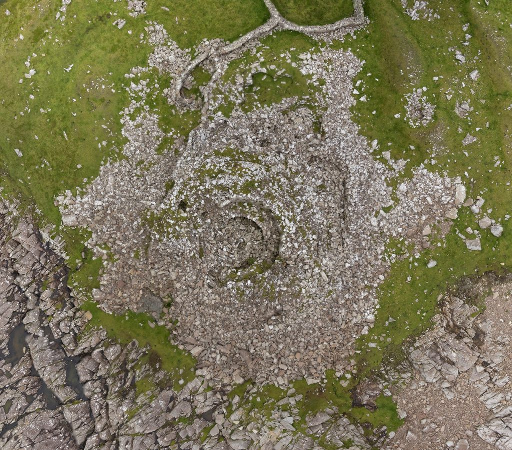 Look closely at this jumble of stone and the concentric circles of a broch outer wall and inserted wheel house will reveal themselves. This is Levenwick Broch in Shetland. Photo by Eddie Martin.