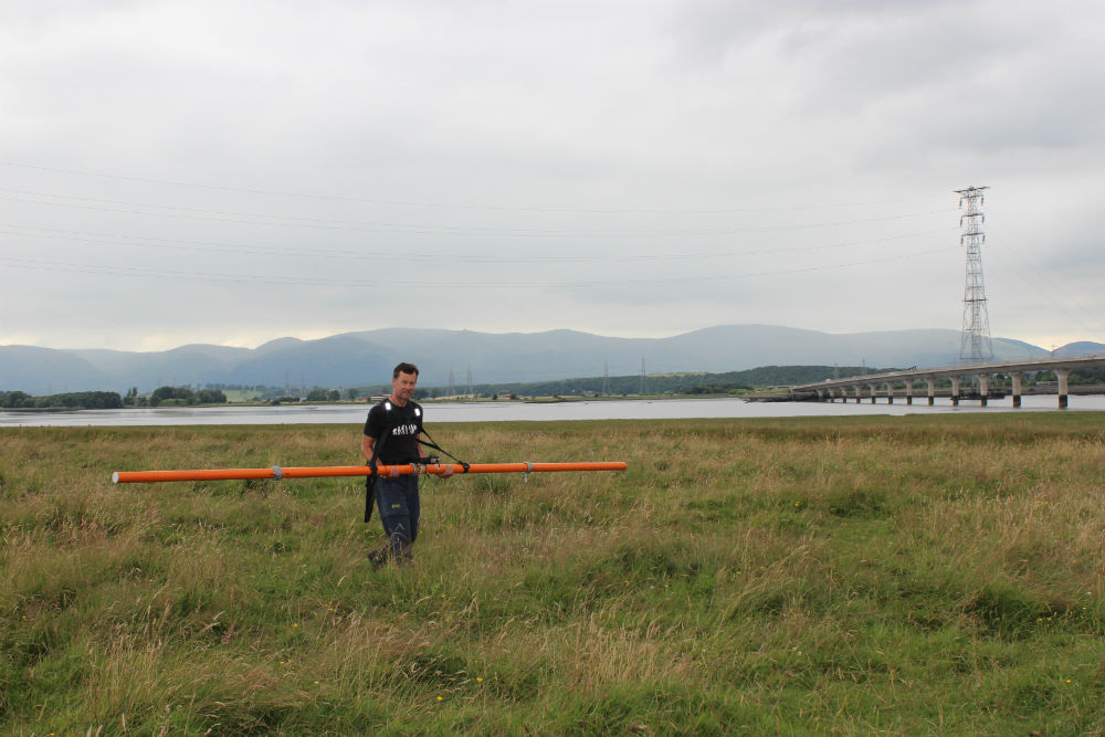 Richard Bates, University of St Andrews carrying out electromagnetic conductivity survey.