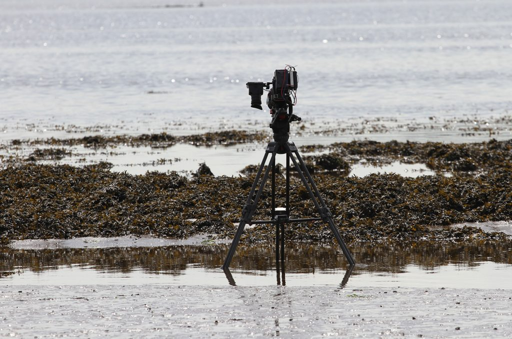 Camera filming the tide go out
