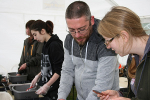 Ellie and Darren discuss pottery - during a rainy Sunday morning finds washing in the site marquee