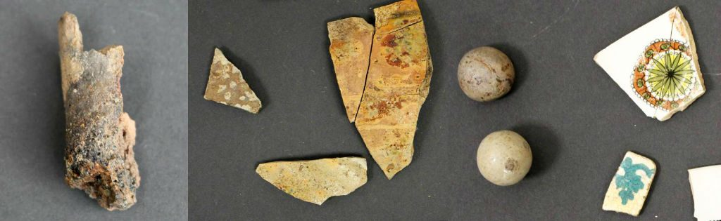 A row of 3 images showing finds. On the left, a fragment of a vitrified clay object. In the centre, medieval green-glazed pottery sherds. On the right, more recent clay marbles and decorated pottery sherds