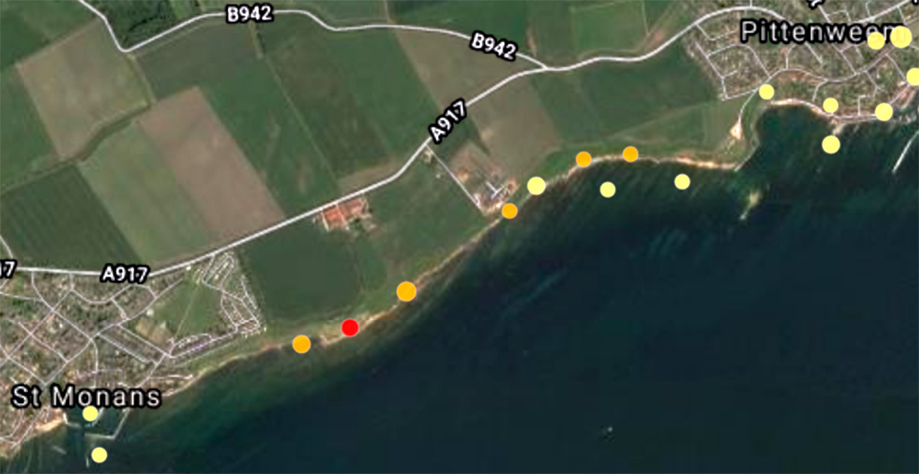 Satellite image of coast between Pittenweem and St Monans with red, orange and yellow dots scattered along it